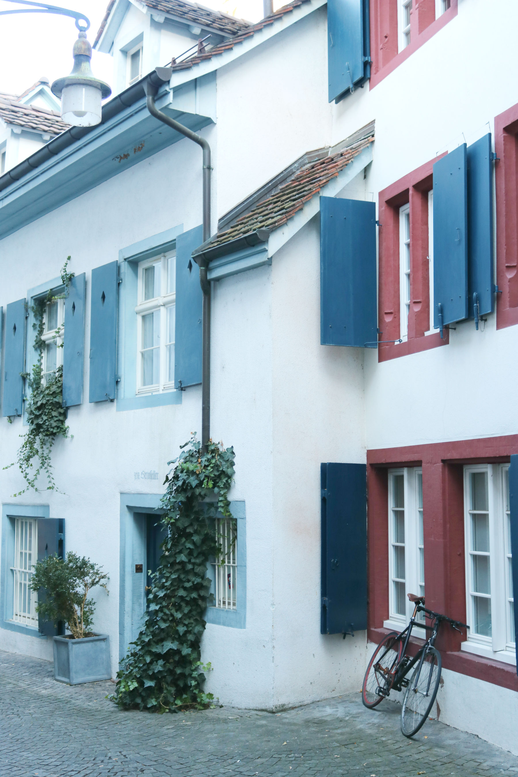 White houses with red and blue shutters in Basel, Switzerland