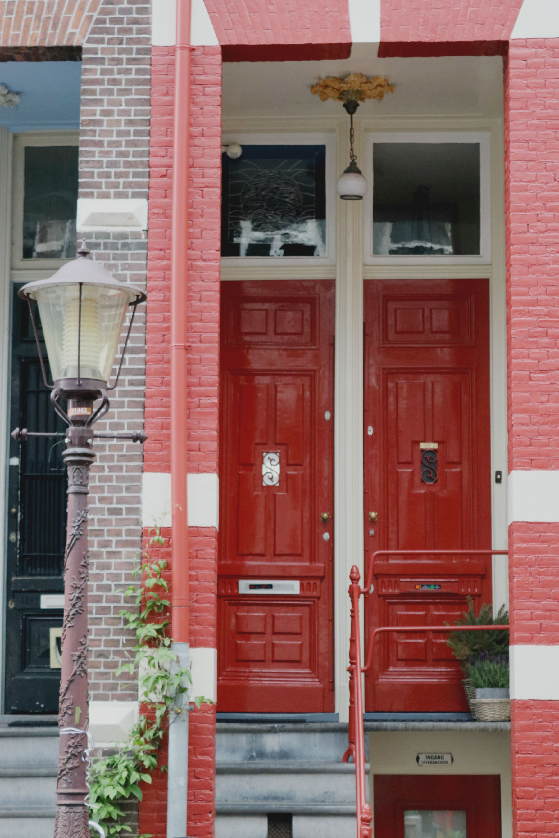 Two red front doors in Amsterdam