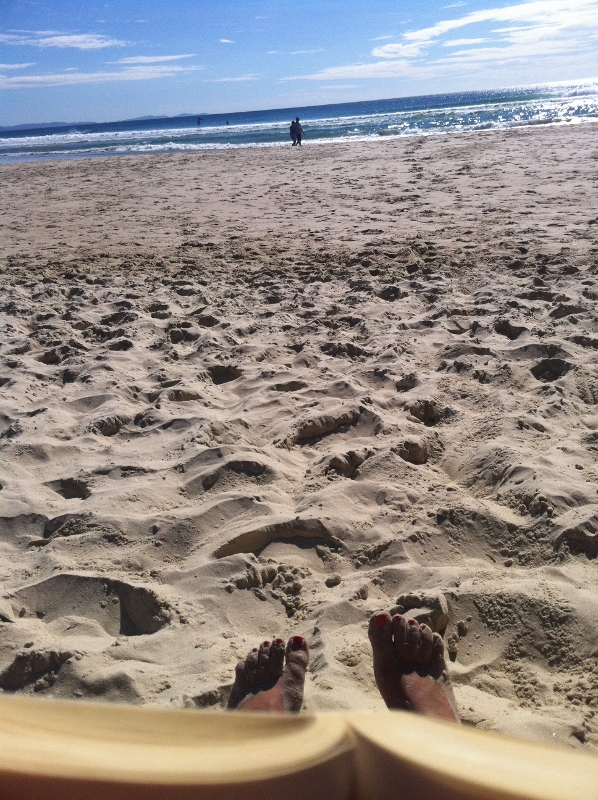 Relaxing on the beach at Byron Bay
